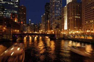 Chicago skyline and river at night from Wells Street Bridge