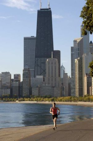 Jogger at North Avenue Beach, Chicago skyline - Chicago photos