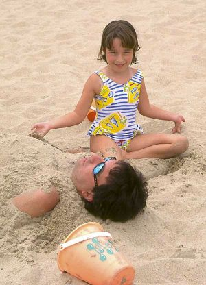 Little girl on sand at Oak Street Beach - Chicago lakefront photographs