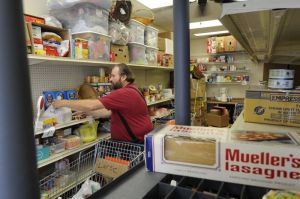 Stocking shelves at the food pantry
